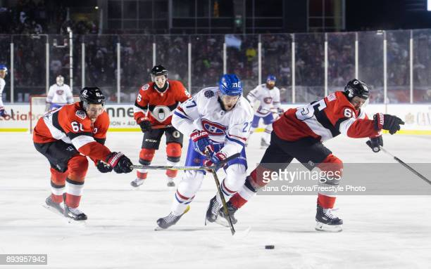 Alex Galchenyuk the Montreal Canadiens skates with the puck against Mark Stone and Erik Karlsson of the Ottawa Senators during the of the 2017...