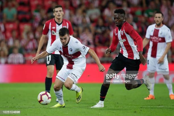 Alex Gallar of SD Huesca Inaki Williams of Athletic Bilbao during the La Liga Santander match between Athletic de Bilbao v SD Huesca at the Estadio...