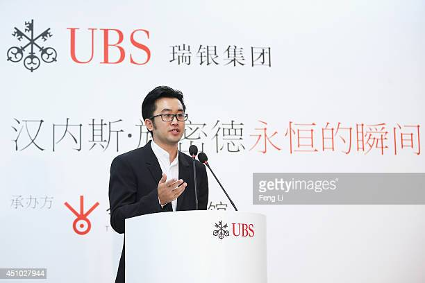 Alex Gao, Executive Director of Today Art Museum speaks during the opening of Swiss artist photographer Hannes Schmid's MOMENTOUS presented by UBS at...