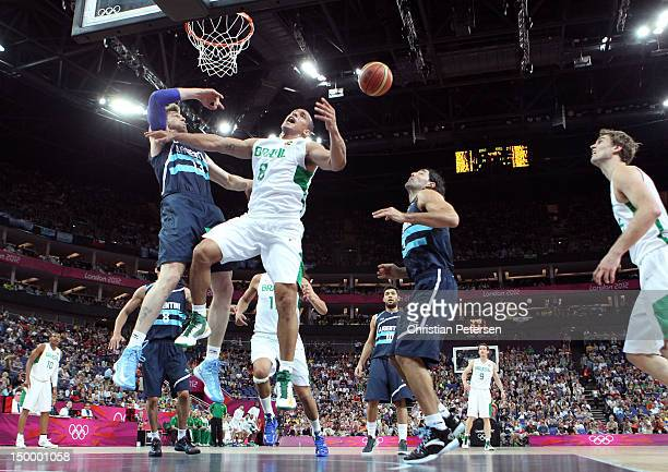 Alex Garcia of Brazil goes up for a shot against Andres Nocioni of Argentina in the first half during the Men's Basketball quaterfinal game on Day 12...