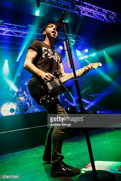Alex Gaskarth of All Time Low performs on stage at Manchester Academy on March 13 2014 in Manchester United Kingdom