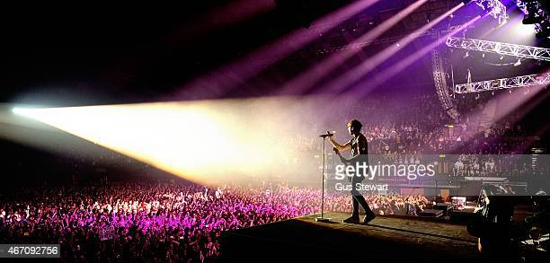 Alex Gaskarth of All Time Low performs on stage at Wembley Arena on March 20 2015 in London United Kingdom