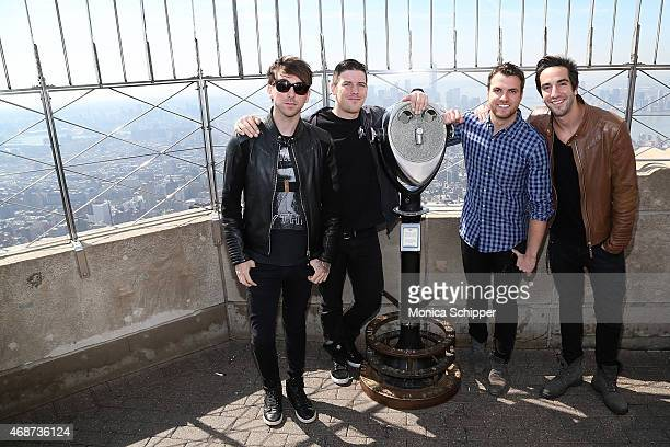Alex Gaskarth Zack Merrick Rian Dawson and Jack Barakat all of band All Time Low visit The Empire State Building on April 6 2015 in New York City