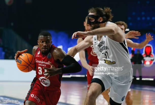 Alex Gavrilovic of Nizhny Novgorod in action against Dylan Ennis of Casademont Zaragoza during FIBA Champions League Final 8 basketball match between...