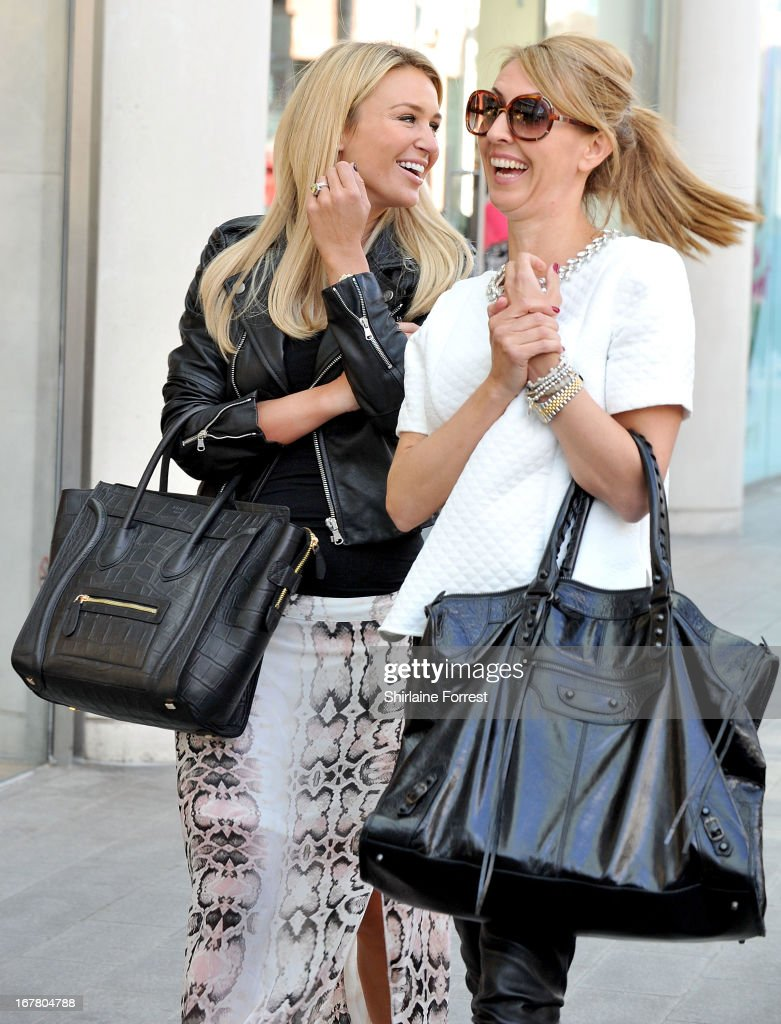 Alex Gerrard (L) accompanied by her publicist arrives to be announced as the face of Lipsy VIP at Lipsy on April 30, 2013 in Liverpool, England.