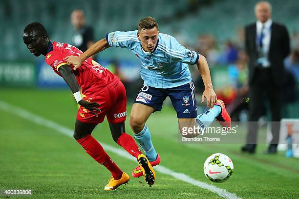Alex Gersbach of Sydney competes with Awer Mabil of Adelaide during the round 13 ALeague match between Sydney FC and Adelaide United at Allianz...