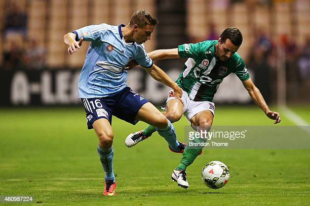 Alex Gersbach of Sydney competes with James Virgili of the Jets during the round 15 ALeague match between Sydney FC and Newcastle Jets at WIN Stadium...