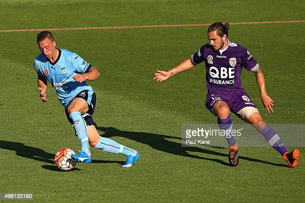 Alex Gersbach of Sydney controls the ball against Josh Risdon of the Glory during the round seven ALeague match between Perth Glory and Sydney FC at...