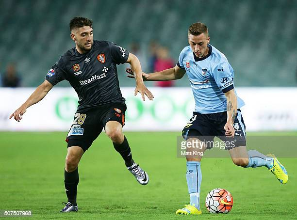 Alex Gersbach of Sydney FC is challenged by Brandon Borrello of the Roar during the round 17 ALeague match between Sydney FC and the Brisbane Roar at...