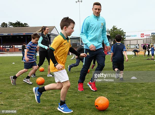 Alex Gersbach participates in a coaching clinic during the Caltex Socceroos Fan Day at North Port Oval on October 9 2016 in Melbourne Australia