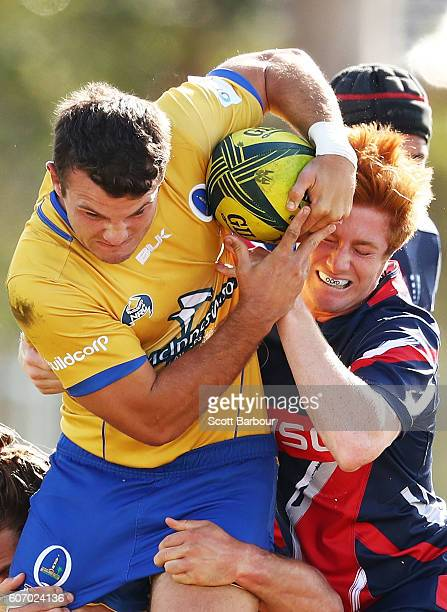Alex Gibbon of City is tackled by Nic Stirzaker of the Rising during the round four NRC match between Melbourne Rising and Brisbane City at...