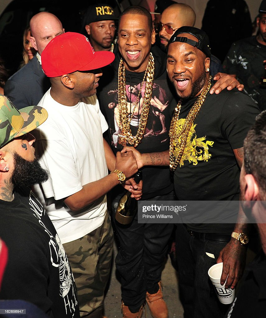 Alex Gidewon, Jay-Z and Young Jeezy attend the So So Def anniversary party hosted by Jay Z at Compound on February 23, 2013 in Atlanta, Georgia.