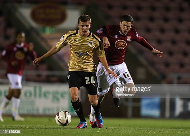 Alex Gilbey of Colchester United looks to control the ball under pressure from Ben Tozer of Northampton Town during the Johnstone's Paint Trophy...