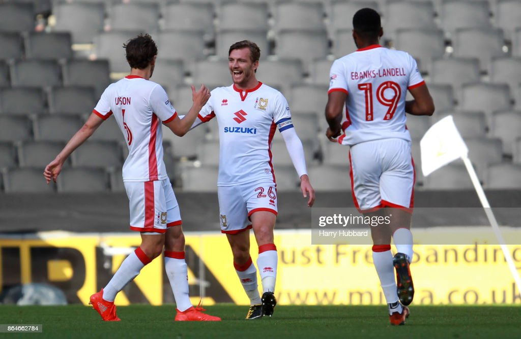 Alex Gilbey of Milton Keynes Dons celebrates scoring his side's first goal during the Sky Bet League One match between Milton Keynes Dons and Oldham Athletic at StadiumMK on October 21, 2017 in Milton Keynes, England.