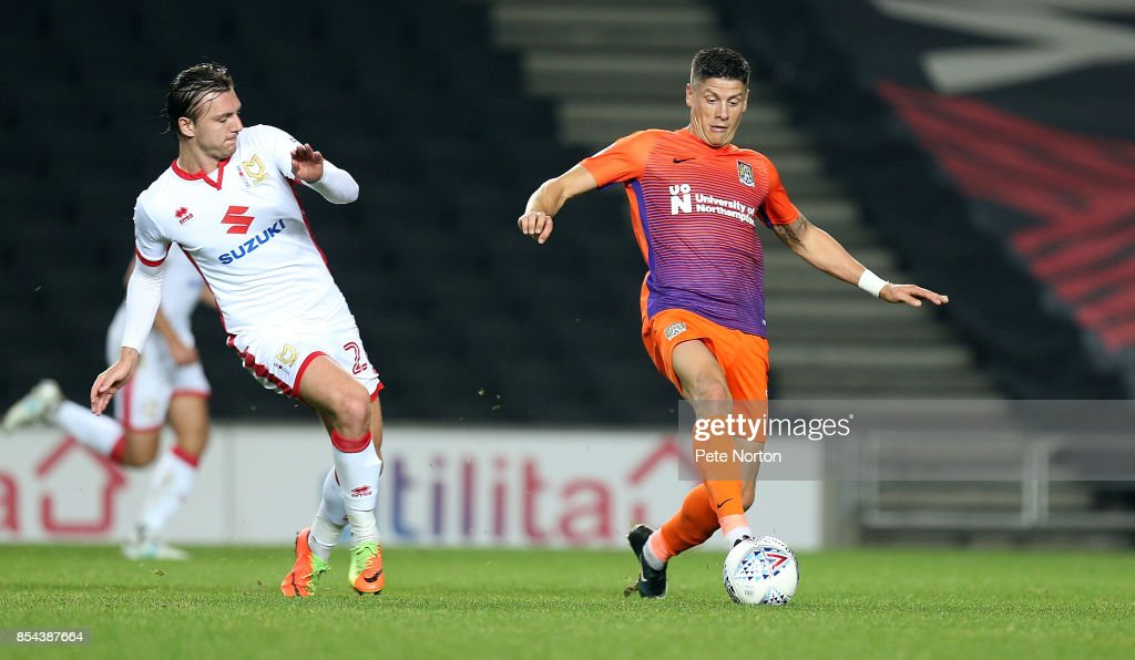 Alex Gilbey of Milton Keynes Dons contests the ball with Alex Revell of Northampton Town during the Sky Bet League One match between Milton Keynes Dons and Northampton Town at StadiumMK on September 26, 2017 in Milton Keynes, England.