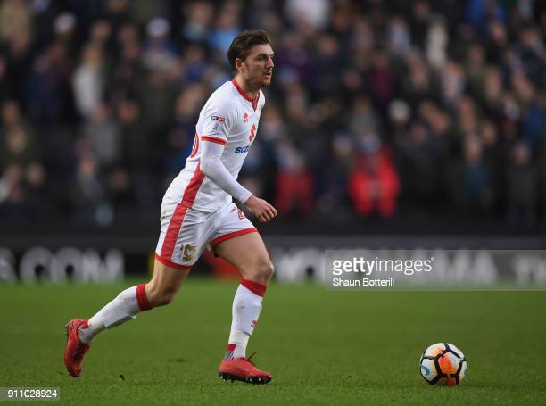 Alex Gilbey of Milton Keynes Dons runs with the ball during the Emirates FA Cup Fourth Round match between Milton Keynes Dons and Coventry City at...