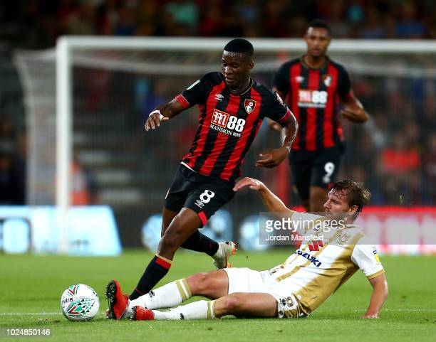 Alex Gilbey of Milton Keynes Dons tackles Jefferson Lerma of AFC Bournemouth during the Carabao Cup Second Round match between AFC Bournemouth and...