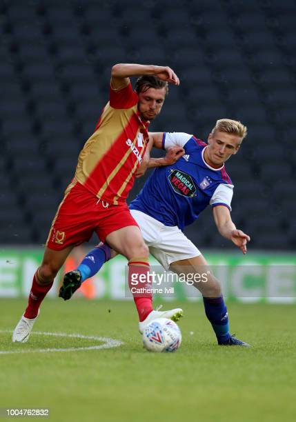 Alex Gilbey of MK Dons and Flynn Downes of Ipswuch Town during the Pre Season Friendly between Milton Keynes Dons and Ipswich Town at StadiumMK on...