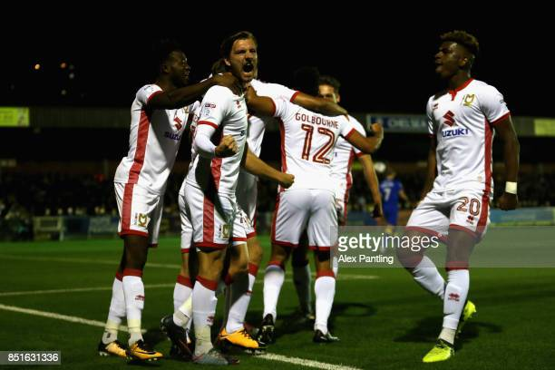 Alex Gilbey of MK Dons celebrates with team mates after Ryan Seagen of MK Dons scores his sides first goal during the Sky Bet League One match...