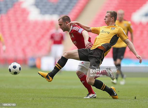 Alex Gilbey of Newport County tries to tackle Neil Ashton of Wrexham during the Blue Square Bet Premier Conference Playoff Final between Wrexham and...