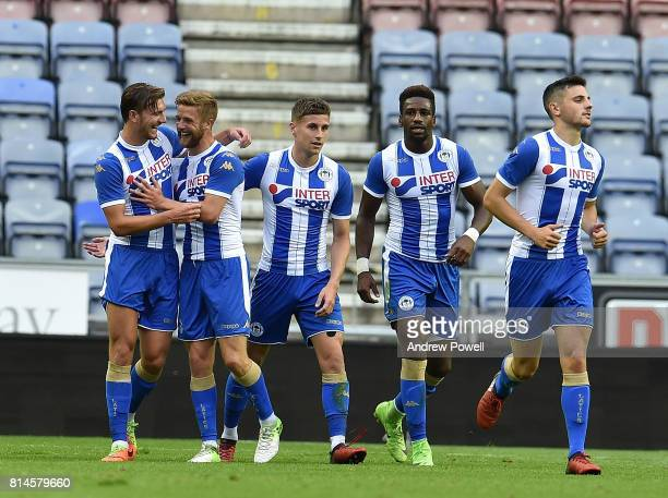 Alex Gilbey of Wigan Scores the first and celebrates during a Pre Season Friendly match between Wigan Athletic and Liverpool at DW Stadium on July 14...