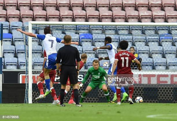 Alex Gilbey of Wigan Scores the first during a Pre Season Friendly match between Wigan Athletic and Liverpool at DW Stadium on July 14 2017 in Wigan...