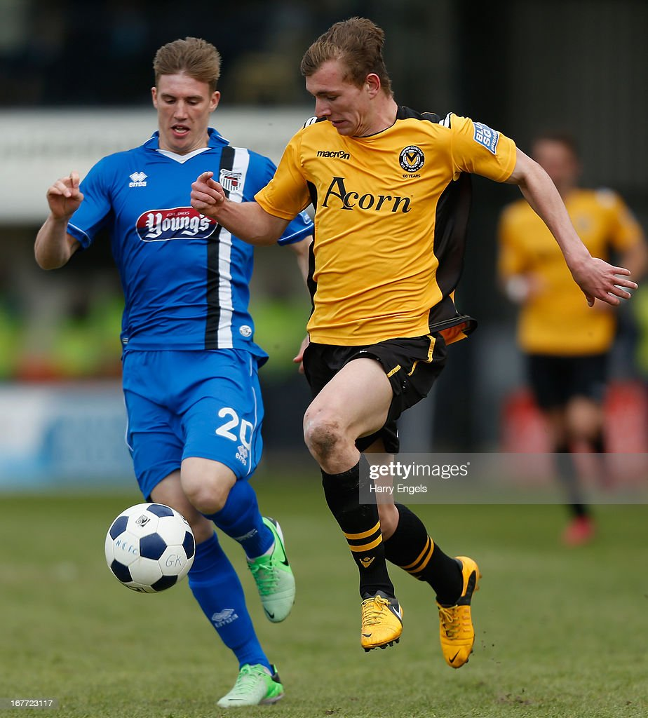 Alex Gilby of Newport County (R) battles for the ball with Dayle Southwell of Grimsby Town during the Blue Square Bet Premier Conference Play-off second leg match between Newport County A.F.C. and Grimsby Town at Rodney Parade on April 28, 2013 in Newport, Wales.