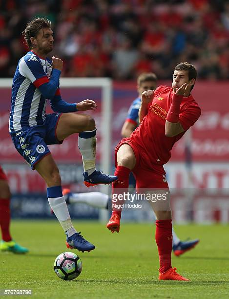 Alex Gilby of Wigan Athletic challenges Jon Flanagan of Liverpool during the PreSeason Friendly match between Wigan Athletic and Liverpool at JJB...