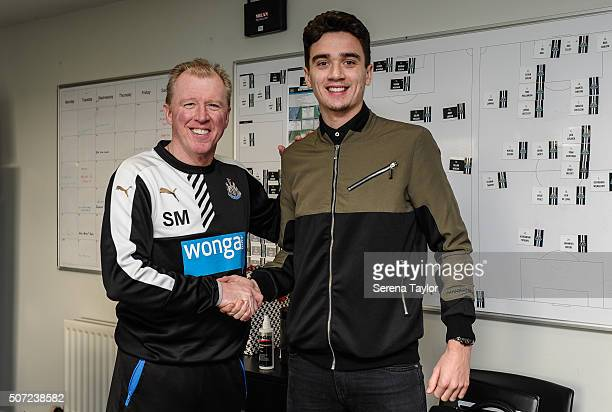 Alex Gilliead shakes hands with Newcastle Manager Steve McClaren after signing a new 2 and a half year contract at The Newcastle United Training...