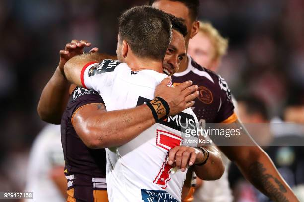 Alex Glenn of the Broncos and Ben Hunt of the Dragons embrace after the match during the round one NRL match between the St George Illawarra Dragons...
