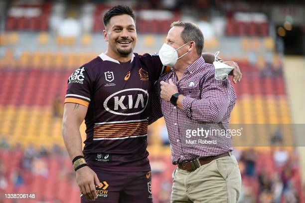 Alex Glenn of the Broncos and coach Kevin Walters share a laugh after the round 25 NRL match between the Brisbane Broncos and the Newcastle Knights...