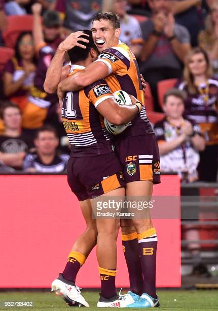 Alex Glenn of the Broncos celebrates with Corey Oates after scoring a try during the round two NRL match between the Brisbane Broncos and the North...