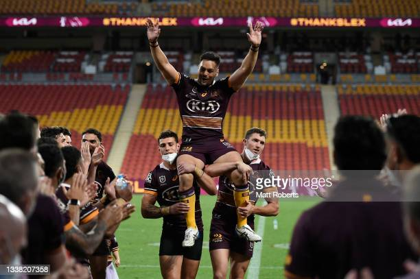 Alex Glenn of the Broncos is chaired off the field after the round 25 NRL match between the Brisbane Broncos and the Newcastle Knights at Suncorp...
