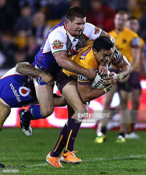Alex Glenn of the Broncos is tackled by Jacob Lillyman of the Warriors during the round 15 NRL match between the New Zealand Warriors and the...