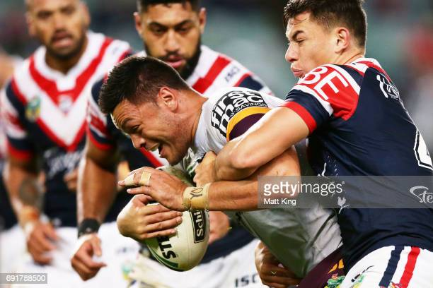 Alex Glenn of the Broncos is tackled during the round 13 NRL match between the Sydney Roosters and the Brisbane Broncos at Allianz Stadium on June 3...