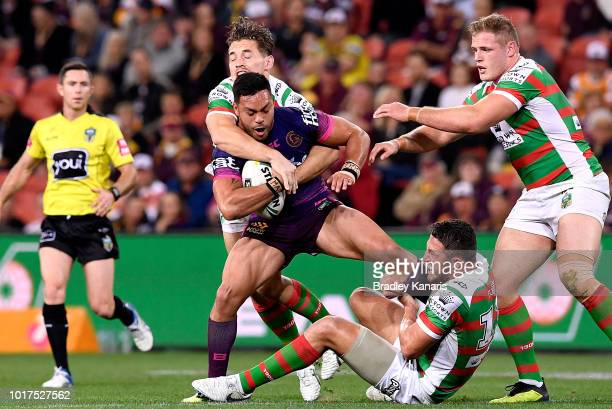 Alex Glenn of the Broncos is tackled during the round 23 NRL match between the Brisbane Broncos and the South Sydney Rabbitohs at Suncorp Stadium on...