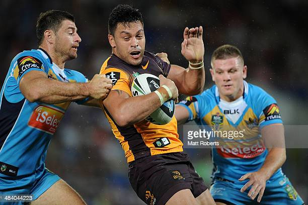 Alex Glenn of the Broncos is tackled during the round 6 NRL match between the Gold Coast Titans and the Brisbane Broncos at Cbus Super Stadium on...