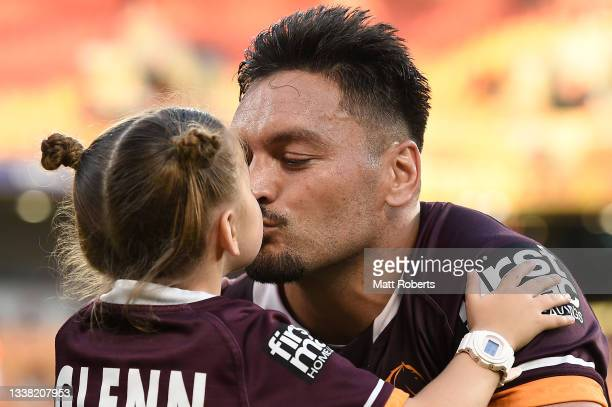 Alex Glenn of the Broncos kisses his daughter after the round 25 NRL match between the Brisbane Broncos and the Newcastle Knights at Suncorp Stadium,...