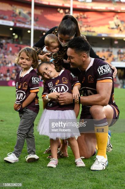 Alex Glenn of the Broncos poses for a photograph with his family after the round 25 NRL match between the Brisbane Broncos and the Newcastle Knights...