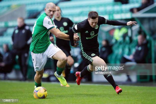 Alex Gogic of Hibernian FC battles for possession with Callum McGregor of Celtic during the Ladbrokes Scottish Premiership match between Hibernian...