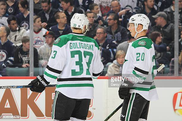 Alex Gogligoski and Cody Eakin of the Dallas Stars discuss strategy during a first period stoppage in play against the Winnipeg Jets at the MTS...