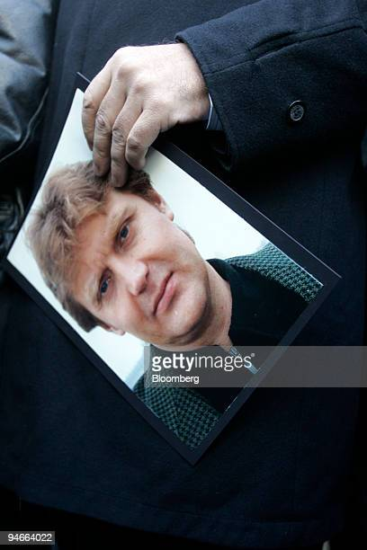 Alex Goldfarb holds a picture of Alexander Litvinenko as he talks to the press on the first anniversary of Alexander Litvinenko's death in London UK...