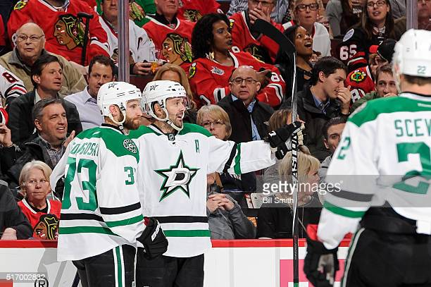 Alex Goligoski and Vernon Fiddler of the Dallas Stars celebrate after Fiddler scored his second goal in the first period of the NHL game against the...