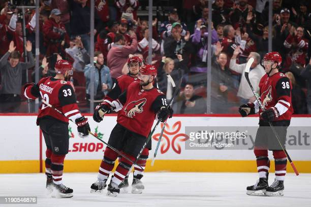 Alex Goligoski, Michael Grabner, Brad Richardson and Christian Fischer of the Arizona Coyotes celebrate after Goligoski scored a goal against the...