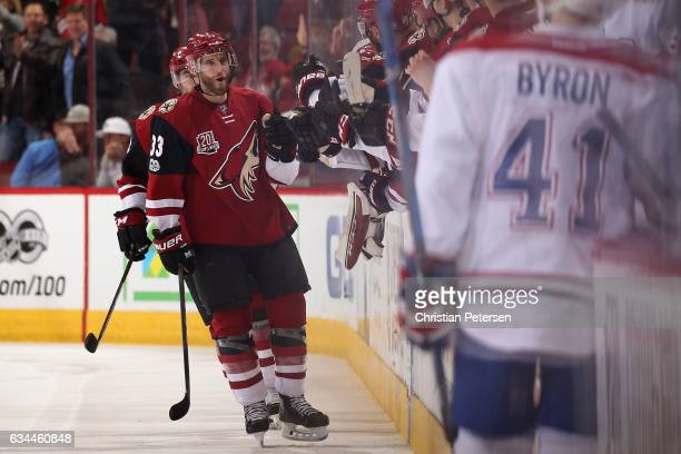 Alex Goligoski of the Arizona Coyotes celebrates with teammates on the bench after scoring a shorthanded goal against the Montreal Canadiens during...