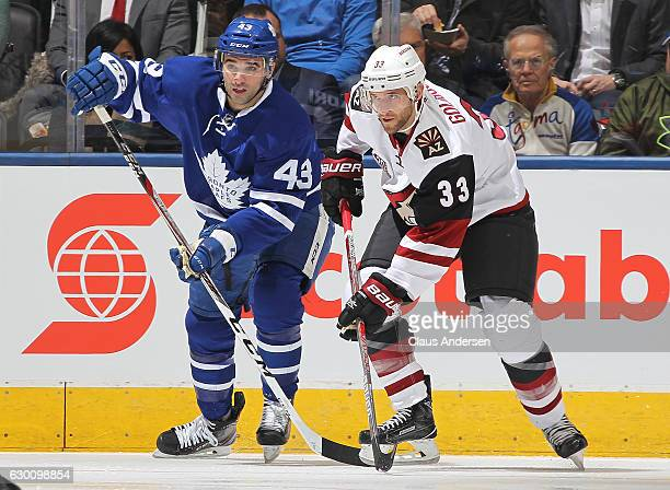 Alex Goligoski of the Arizona Coyotes skates against Nazem Kadri of the Toronto Maple Leafs during an NHL game at the Air Canada Centre on December...