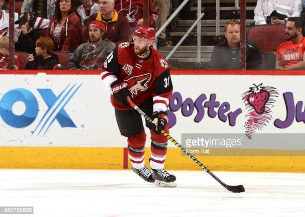Alex Goligoski of the Arizona Coyotes skates with the puck against the Ottawa Senators at Gila River Arena on March 9 2017 in Glendale Arizona