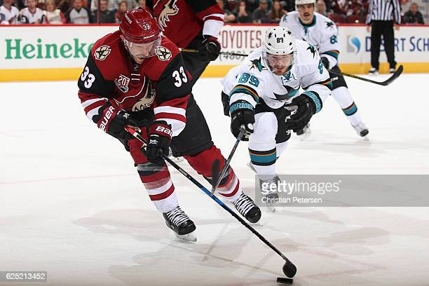Alex Goligoski of the Arizona Coyotes skates with the puck during the NHL game against the San Jose Sharks at Gila River Arena on November 19 2016 in...