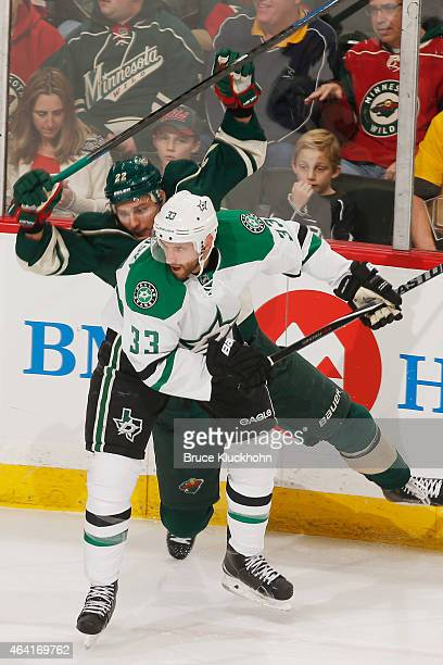 Alex Goligoski of the Dallas Stars and Nino Niederreiter of the Minnesota Wild collide during the game on February 22 2015 at the Xcel Energy Center...