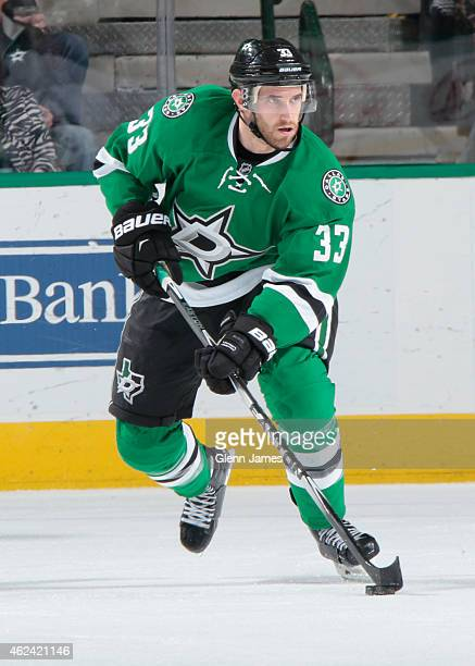 Alex Goligoski of the Dallas Stars handles the puck against the Winnipeg Jets at the American Airlines Center on January 15 2015 in Dallas Texas